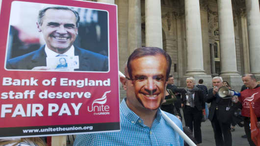 Bank of England workers on strike outside the institution's Threadneedle Street headquarters in London.