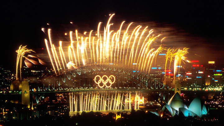 The Sydney Harbour Bridge is lit up with Fireworks after the Closing Ceremony of the Sydney 2000 Olympic Games, Sydney Australia.