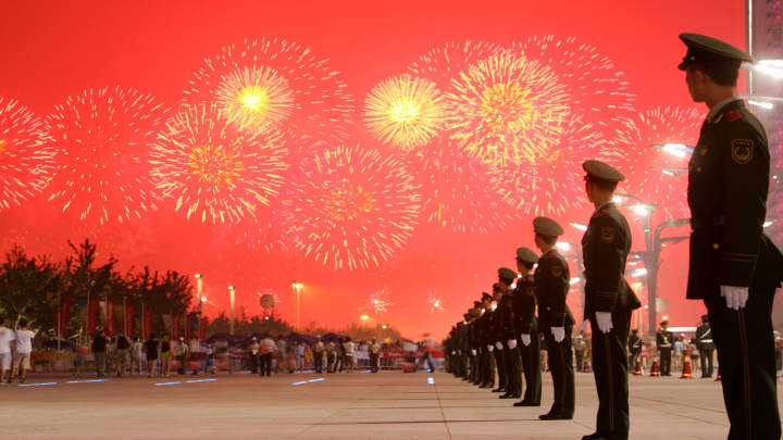 Fireworks light up the sky as paramilitary policemen stand guard during the Opening Ceremony for the Beijing 2008 Olympic Games on August 8, 2008 in Beijing, China.