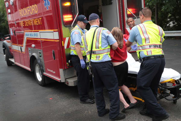 Firefighters help an overdose victim on July 14, 2017 in Rockford, Illinois.