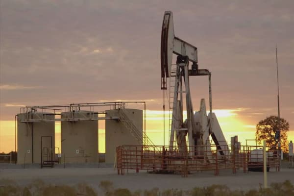 Oil prices slip from more than two-month highs as some exporters raise output