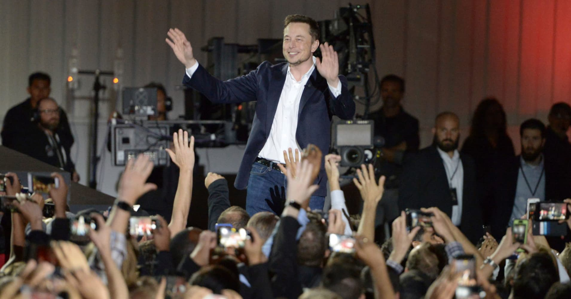 Tesla CEO Elon Musk is celebrated by employees during the presentation of Model 3 vehicles in Fremont, California, July 28, 2017.