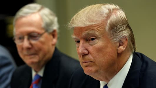 Senate Majority Leader Mitch McConnell (L) sits beside U.S. President Donald Trump during a leadership lunch at the White House in Washington.