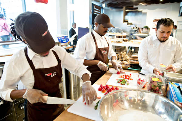 Employees cut fresh strawberries at a Ferrero SpA Nutella Cafe in Chicago.
