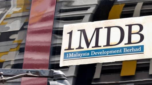 Logo of 1MDB (1Malaysia Development Berhad) on a bus window in Kuala Lumpur, Malaysia.