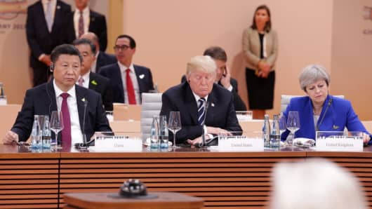 British PM Theresa May, U.S. President Donald Trump and Chinese President Xi Jinping at the G20 summit on July 7, 2017 in Hamburg, Germany.