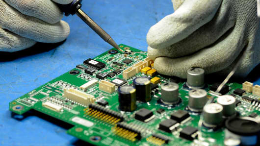 An employee works on a circuit board at Jabil Circuit's facility in St. Petersburg, Florida.