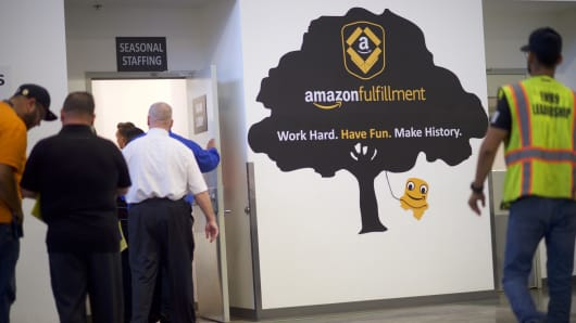 Job seekers tour the Amazon Fulfillment Center during an Amazon jobs fair on August 2, 2017 in Robbinsville, New Jersey.