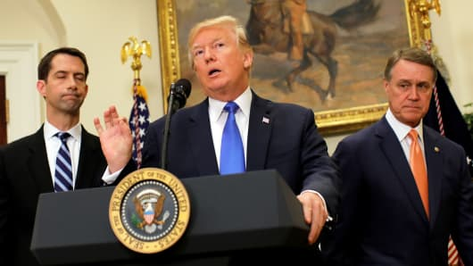 President Donald Trump speaks during an announcement on immigration reform accompanied by Senator Tom Cotton (R-AR) (L) and Senator David Perdue (R-GA) (R), in the Roosevelt Room of the White House in Washington, August 2, 2017.