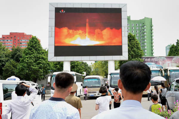 People watch news report showing North Korea's Hwasong-14 missile launch on electronic screen at Pyongyang station, North Korea in this photo taken by Kyodo on July 29, 2017.