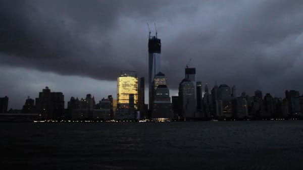The skyline of lower Manhattan, as seen from Exchange Place, is mostly in darkness except for the Goldman Sachs building after a preventive power outage caused by giant storm Sandy, in New York October 30, 2012.