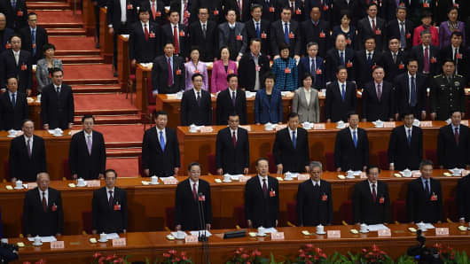 Chinese leaders, second row from left, Politburo Standing Committee member Wang Qishan, Vice Premier Zhang Dejiang, President Xi Jinping, Premier Li Keqiang and others.