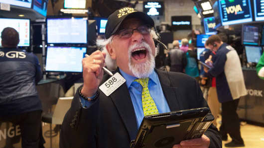 A trader wears a Dow 22,000 points hat on the floor at the closing bell of the Dow Jones Industrial Average at the New York Stock Exchange on August 2, 2017 in New York.