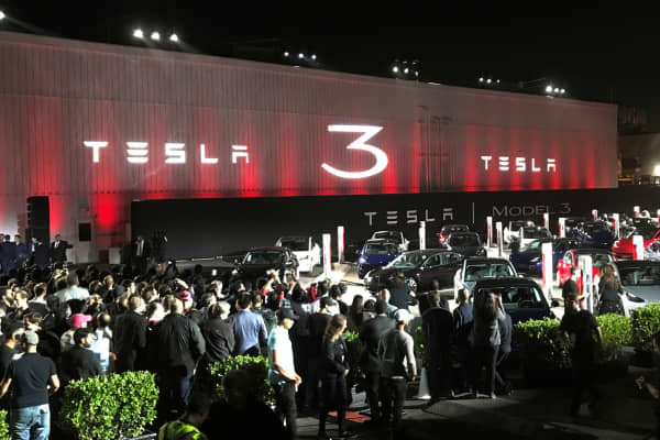 Tesla introduces Model 3 cars off the production line during an event at the company's facilities in Fremont, California, July 28, 2017.
