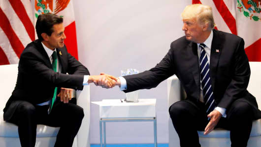 U.S. President Donald Trump shakes hands with Mexico's President Enrique Pena Nieto during the their bilateral meeting at the G20 summit in Hamburg, Germany July 7, 2017.