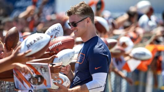Chicago Bears General Manager Ryan Pace signs autographs for fans after a practice session during the Chicago Bears Training Camp on July 29, 2017 at Olivet Nazarene University in Bourbonnais, Illinois.