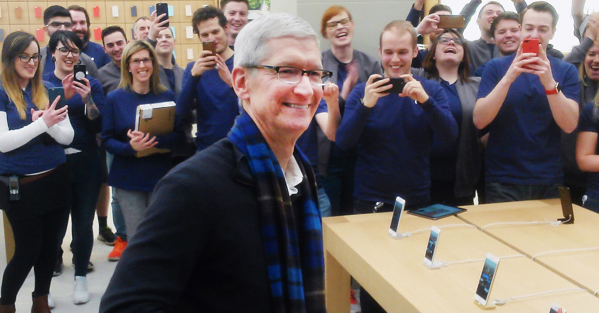 Apple chief executive Tim Cook visits an Apple store in Glasgow.