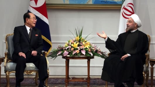 Iran's President Hassan Rouhani meets with North Korea's ceremonial head of state, Kim YongcNam in 2013.