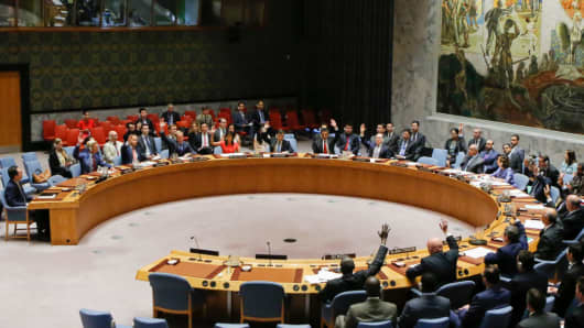 UN Security Council members vote on a US-drafted resolution toughening sanctions on North Korea, at the UN Headquarters in New York on August 5, 2017.