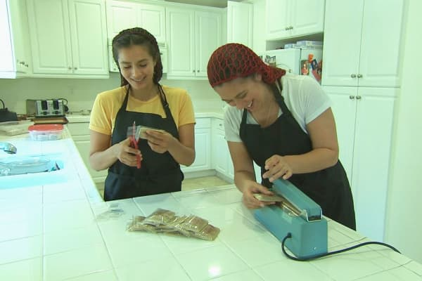 Cindy and Leone packaging their marijuana-infused mini toaster pastries.