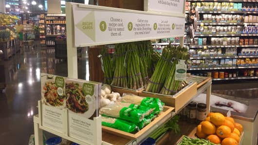 """The Dinner Table"" display at a Whole Foods in Rockville, Maryland, includes a recipe and the ingredients necessary to make it."