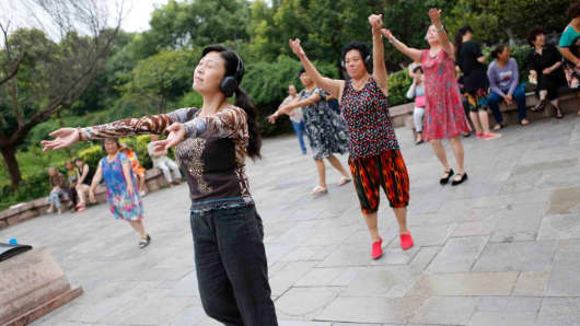 A group of Chinese middle-aged women dance to music on July 31, 2014 in Guiyang, Guizhou Province of China.