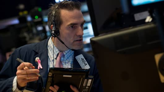 A trader works on the floor of the New York Stock Exchange at the closing bell of the Dow Industrial Average, May 10, 2017 in New York