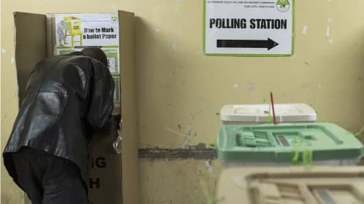 Kenyans vote at a polling station at Olympic Primary School in Kibera.