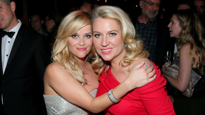 Actress Reese Witherspoon (L) and writer Cheryl Strayed attend The 72nd Annual Golden Globe Awards at The Beverly Hilton on January 11, 2015 in Beverly Hills, California.