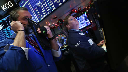 Traders work on the floor of the New York Stock Exchange (NYSE) on January 6, 2016 in New York City.