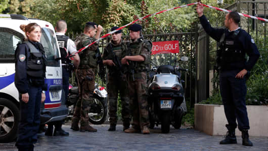 Police and soldiers secure the scene where French soliders were hit and injured by a vehicle in the western Paris suburb of Levallois-Perret, France, August 9, 2017.