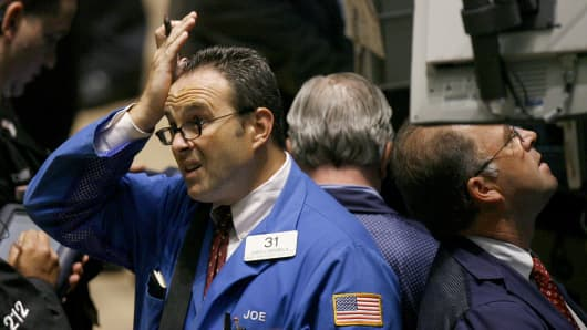 Traders work on the floor of the New York Stock Exchange August 9, 2007.