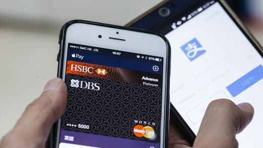 Mobile payment platforms Apple Pay and Alipay are displayed for a photograph in Hong Kong, China, on November 1, 2016.