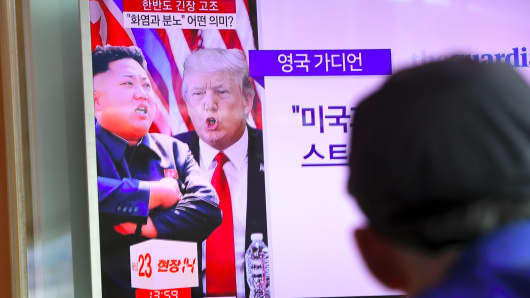U.S. President Donald Trump and North Korean leader Kim Jong Un in the news at a railway station in Seoul on August 9, 2017.