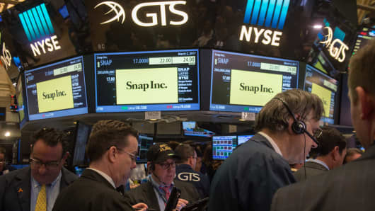 Traders work on the floor during the Snap Inc. IPO at the New York Stock Exchange, March 2, 2017, in New York.