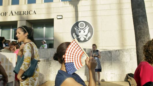A woman holds a fan at the newly-opened US embassy in Cuba, prior to the flag-raising ceremony led by U.S. Secretary of State John Kerry, on August 14, 2015, in Havana, Cuba.