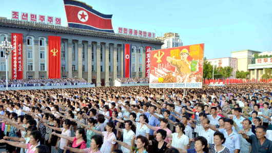 People participate in a Pyongyang city mass rally held at Kim Il Sung Square on August 9, 2017, to fully support the statement of the Democratic People's Republic of Korea (DPRK) government.