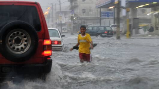 A boy wades through a flooded street in Panama City.