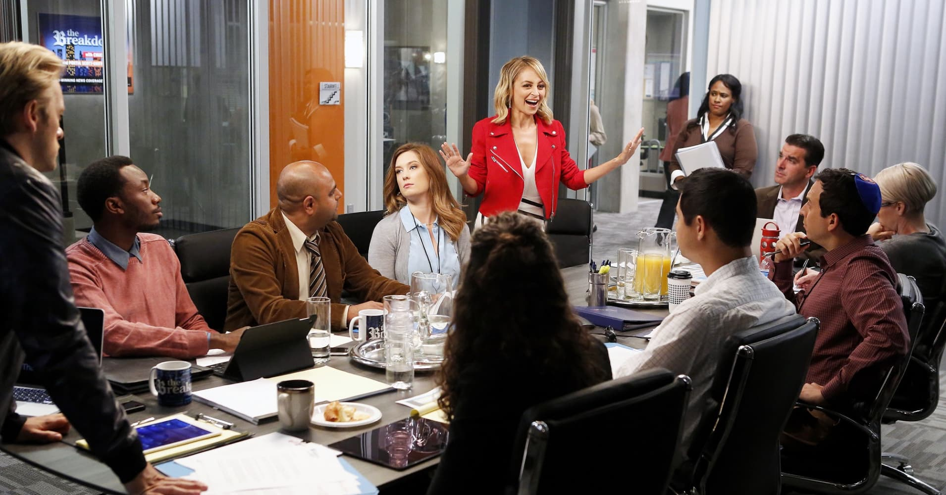 Portia, played by Nicole Richie, shares her idea with her coworkers in an episode of Great News