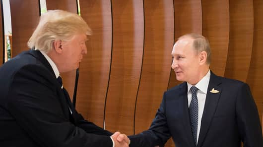 Donald Trump meets Vladimir Putin at the opening of the G20 summit on July 7, 2017 in Hamburg, Germany.