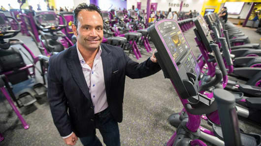 "Chris Rondeau, CEO of Planet Fitness, a low cost gym chain that opened its first Canadian branch in Toronto. The franchise is growing quickly thanks to low prices and its ""judgement free-zone"" mantra."