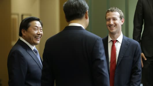 Chinese President Xi Jinping, center, talks with Facebook Chief Executive Mark Zuckerberg, right, as Lu Wei, left, China's Internet czar, looks on during a gathering of CEOs and other executives at Microsoft's main campus in Redmond, Wash.