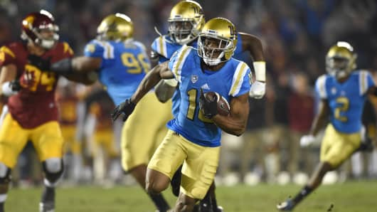UCLA (10) Fabian Moreau (DB) intercepts a pass and runs the ball during an NCAA football game between the USC Trojans and the UCLA Bruins on November 19, 2016, at the Rose Bowl in Pasadena, CA.