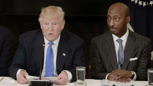 President Donald Trump, speaks while Kenneth Frazier, chairman and chief executive officer of Merck & Co., right, listens during a meeting with manufacturing executives in the State Dining Room of the White House in Washington, D.C., U.S., on Thursday, Feb. 23, 2017.