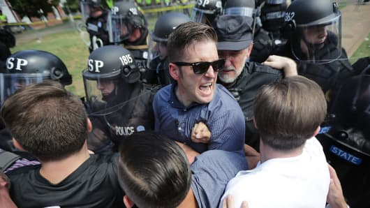 White nationalist Richard Spencer (C) and his supporters clash with Virginia State Police in Emancipation Park after the 'Unite the Right' rally was declared an unlawful gathering August 12, 2017 in Charlottesville, Virginia.