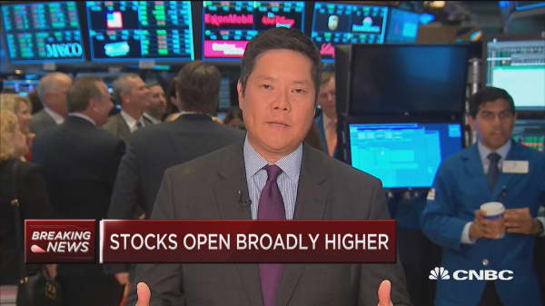 Dow up triple digits at open