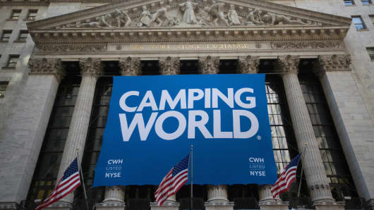 Camping World Holdings Inc. signage is displayed as American Flags fly outside of the New York Stock Exchange (NYSE) during the company's initial public offering (IPO) in New York, U.S., on Friday, Oct. 7, 2016.