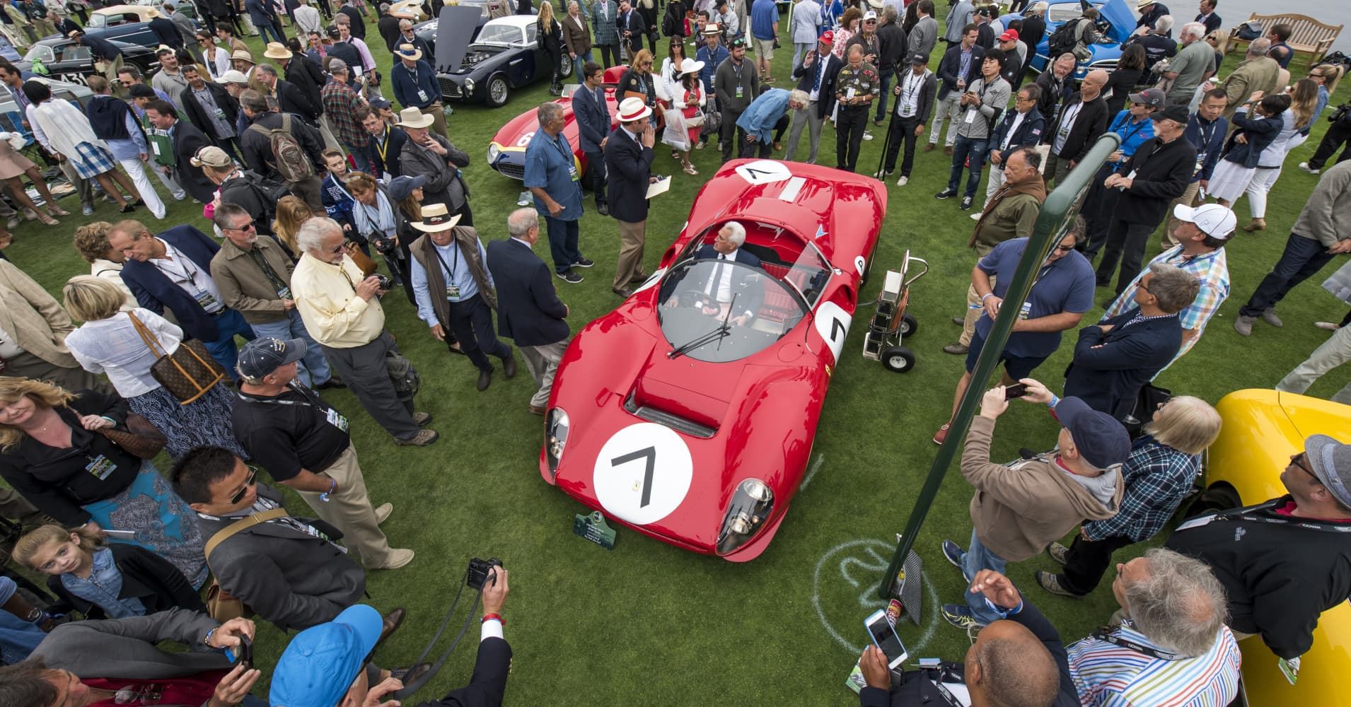 Attendees and judges gather around a 1966 Ferrari 330 P4 Drogo Spyder motor vehicle during the 2016 Pebble Beach Concours d'Elegance in Pebble Beach, California, U.S., on Sunday, Aug. 21, 2016.