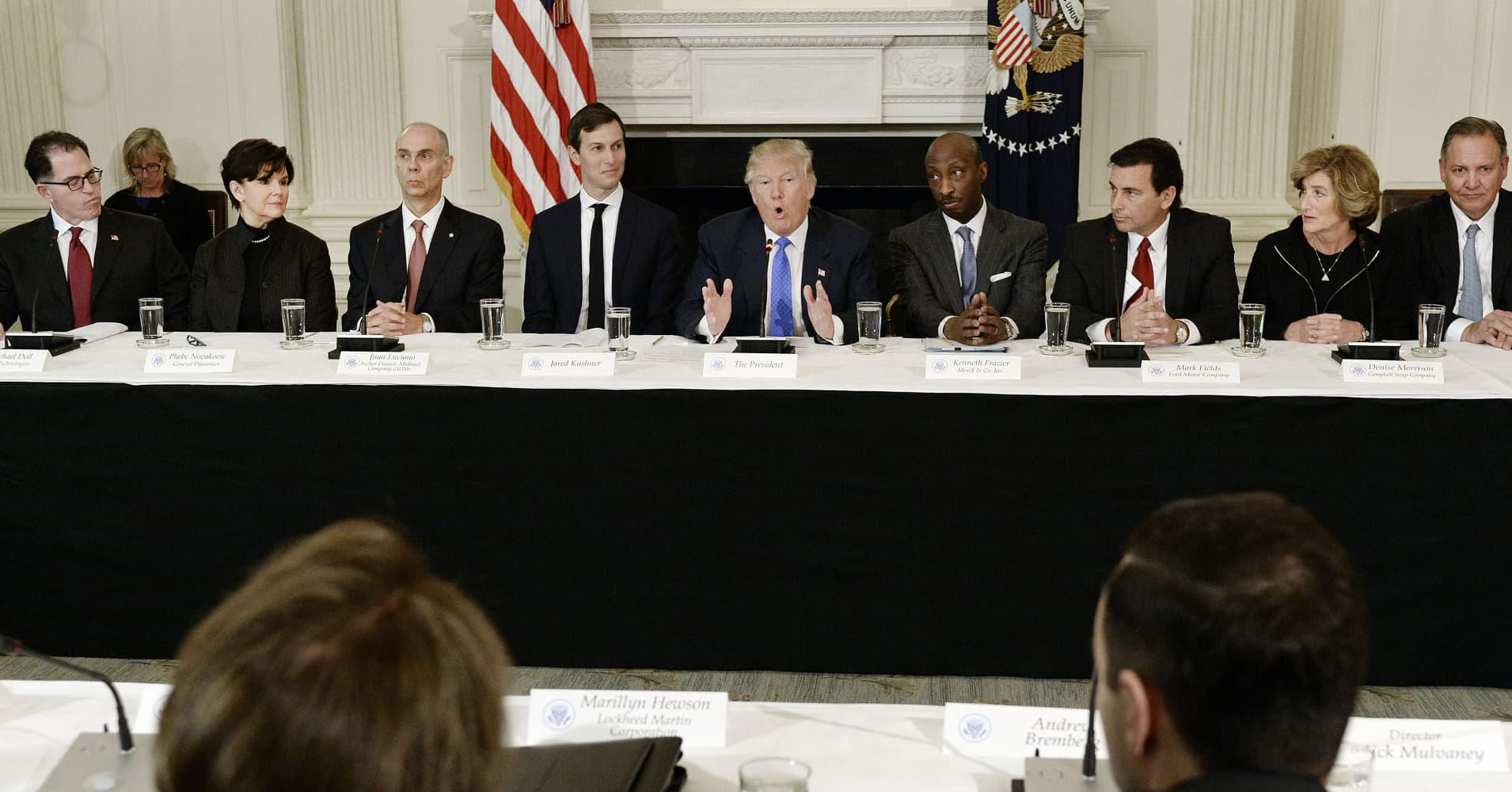 President Donald Trump, center, speaks while Michael Dell, chairman and chief executive officer of Dell Technologies Inc., from left, Phebe Novakovic, chairman and chief executive officer of General Dynamics Corp., Juan Luciano, chairman and chief executive officer of Archer Daniels Midland Co., Jared Kushner, senior White House advisor, Kenneth Frazier, chairman and chief executive officer of Merck & Co., Mark Fields, president and chief executive officer of Ford Motor Co., and Denise Morrison, president and chief executive officer of Campbell Soup Co., listen during a meeting with manufacturing executives in the State Dining Room of the White House in Washington, D.C., U.S., on Thursday, Feb. 23, 2017.