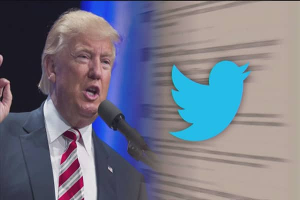 Trump retweets man calling him a fascist and a 'Trump train' rolling through a CNN logo